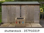 Wooden Garden Shed With A Hose...