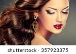 beautiful girl with long wavy... | Shutterstock . vector #357923375