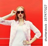 pretty woman in red sunglasses... | Shutterstock . vector #357977327