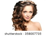 model with long hair. waves... | Shutterstock . vector #358007735