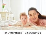 happy family. mother playing... | Shutterstock . vector #358050491