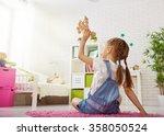 happy child girl. little girl... | Shutterstock . vector #358050524