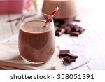 glass of chocolate milk on... | Shutterstock . vector #358051391