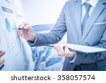 businessman analyzing... | Shutterstock . vector #358057574