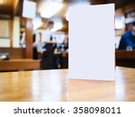 mock up menu frame on table in... | Shutterstock . vector #358098011