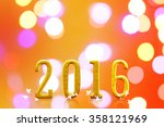 2016 year. on blurred bokeh... | Shutterstock . vector #358121969