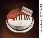 Small photo of Birthday cake decorated with fondant, rounded, symbolically presenting piano and cello instruments.