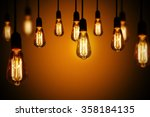 light bulbs on a warm gradient... | Shutterstock . vector #358184135