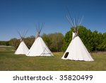 A Small Group Of Tepees In A...