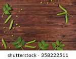 fresh green peas on old wooden... | Shutterstock . vector #358222511