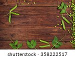 fresh green peas on old wooden... | Shutterstock . vector #358222517