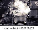 Steam Over Cooking Pot In...