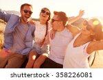 friends on road trip sitting on ... | Shutterstock . vector #358226081