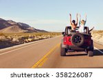 rear view of friends on road... | Shutterstock . vector #358226087