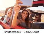 friends on road trip in... | Shutterstock . vector #358230005