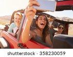 friends on road trip in... | Shutterstock . vector #358230059