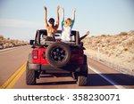 rear view of friends on road... | Shutterstock . vector #358230071