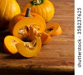 pumpkin slices with seeds on a... | Shutterstock . vector #358237625