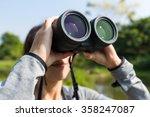 young woman using binocular for ... | Shutterstock . vector #358247087