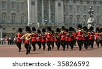 A Guards Band Marching In Fron...