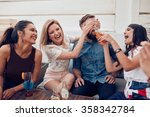 young friends sitting together... | Shutterstock . vector #358342784