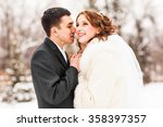 bride and groom kissing in the...   Shutterstock . vector #358397357