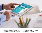 businessman working on tablet... | Shutterstock . vector #358425779