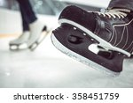 man's hockey skates and women's ... | Shutterstock . vector #358451759