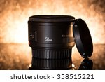 Very popular Canon EF 50mm f/1.8 II lens on black background