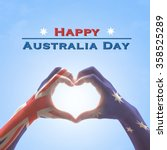Small photo of Happy Australia Day: Australian flag pattern on people hands in heart love shaped form on isolated on blue sky background: National public holiday celebration symbolic concept design idea