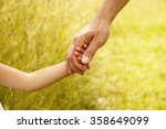 a the parent holds the hand of... | Shutterstock . vector #358649099
