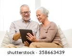 happy senior couple with tablet ... | Shutterstock . vector #358663439