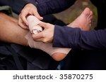 a leg tensor bandage being... | Shutterstock . vector #35870275