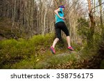 woman training on a trail in... | Shutterstock . vector #358756175