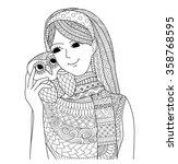 pretty girl holding an owl...   Shutterstock .eps vector #358768595
