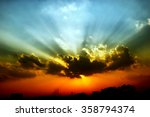 sun rays coming through clouds | Shutterstock . vector #358794374