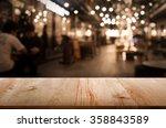 Wood Table  On Blur Bokeh Cafe...