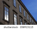 old building facade with blue... | Shutterstock . vector #358915115