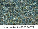 Beach Pebbles Under Clear Wate...