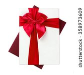 white gift box with red ribbon... | Shutterstock . vector #358973609