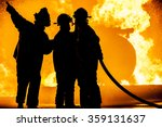 Three Firefighters Fighting A...