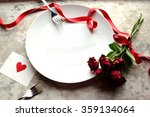 Stock photo red rose bouquet with white dish image of meal for valentines day 359134064