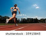 athletic woman running on track | Shutterstock . vector #35915845