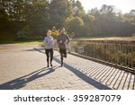 happy couple running outdoors | Shutterstock . vector #359287079