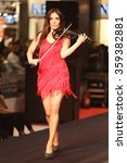 Small photo of ISTANBUL, TURKEY - NOVEMBER 07, 2015: Violinist Giselle Tavilson performs during Optimum Fashion days catwalk
