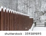 Brown Garden Fence With Snow  ...