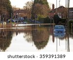 A Flooded Road Junction With A...