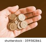 Hand With British Pound Coins...
