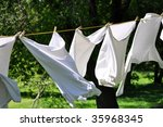 Stock photo white clean laundry hanging on the clothesline 35968345