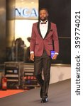 Small photo of ISTANBUL, TURKEY - NOVEMBER 07, 2015: Retired� French� footballer Pascal Olivier Nouma showcase one of the latest creations of Stores in Optimum Outlet during Optimum Fashion days catwalk